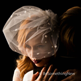 birdcage veil with tiny flowers and pearls