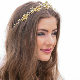 wedding crown in gold and ivory with gold metal leaves and pearls